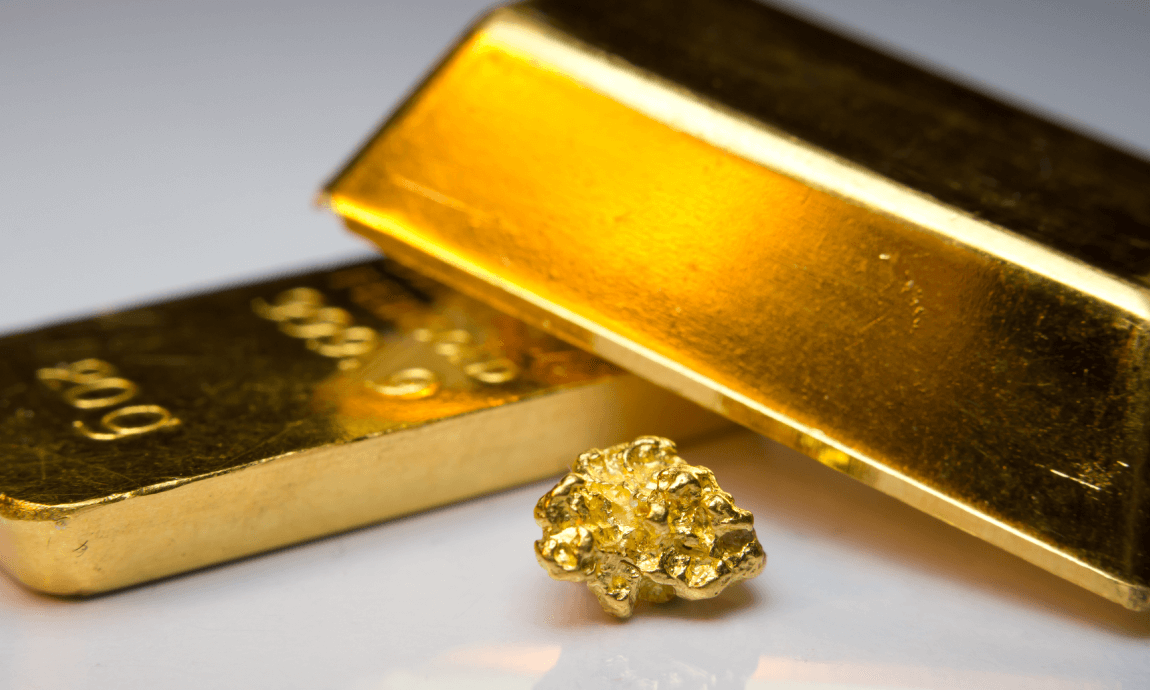 Gold falls below $1.800/oz on improving risk appetite