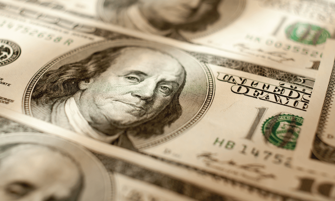 US dollar falls to one-month low on Federal Reserve's dovish stance